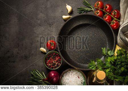 Food Background On Black Slate Table. Ingredients For Cooking Food - Tomatoes, Onion, And Herbs With
