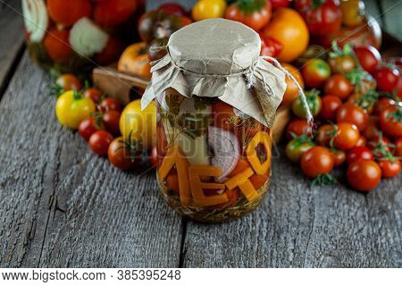 Preservation Of The Autumn Harvest Of Vegetables. Glass Jar With Pickled Tomatoes. Vegetable Food. T