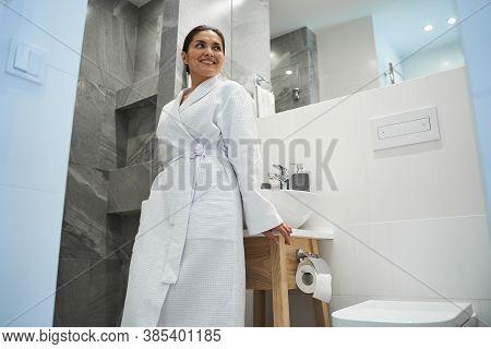 Joyous Woman In A Bathrobe Gazing Away