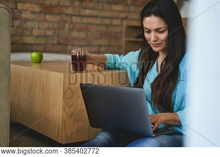 Concentrated Lady Writing An Email On Her Computer
