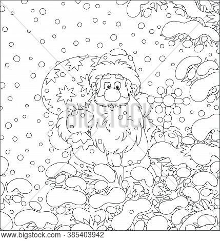 Santa Claus With His Magic Bag Of Christmas Gifts Among Snow-covered Fir Branches Of A Winter Forest