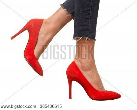 Woman Wearing Red Suede High Heel Shoes And Blue Jeans Isolated On White Background.