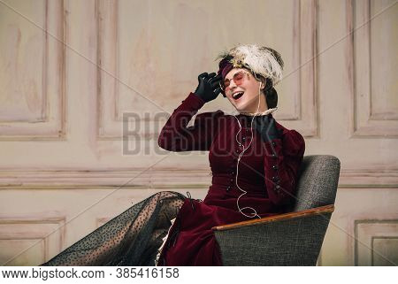 Listening To Music In Earphones. Modern Trendy Look Of Portrait Of An Unknown Woman. Retro Style, Co