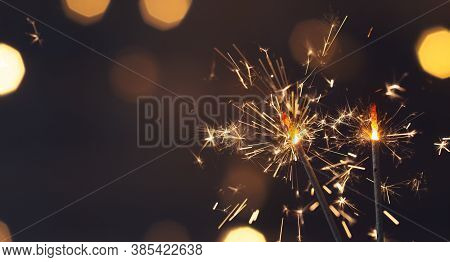 Sparkler Or Bengal Fire On Black Night Lighting Background, Christmas And New Year Party Celebration