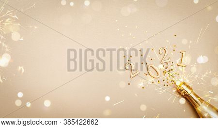 Creative Christmas And New Year Greeting Card With Golden Champagne Bottle, Confetti Stars And 2021