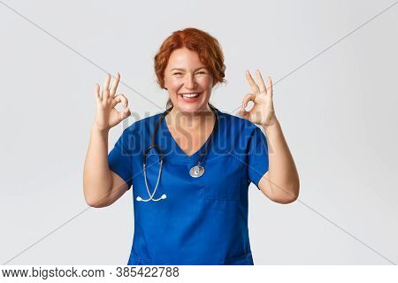 Medicine, Healthcare And Coronavirus Concept. Happy Laughing And Smiling Cute Middle-aged Medical Wo