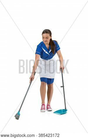 Cheerful During Work. Portrait Of Female Made, Housemaid, Cleaning Worker In White And Blue Uniform