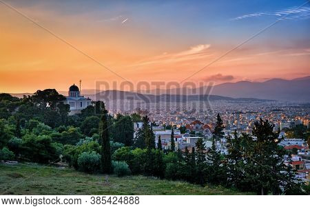 View Of Athens, Greece And Residential Areas From Pnyx Hill In Soft Sunlight And Great Sunset Sky. N