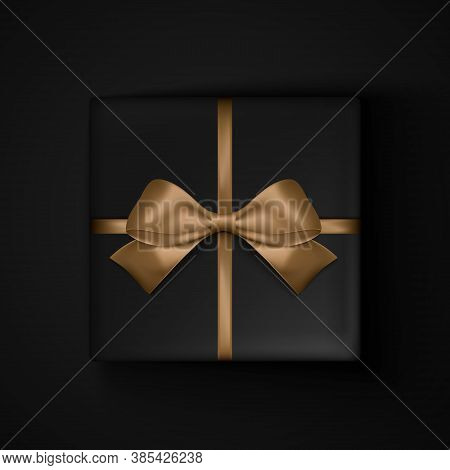 Black Gift Box With Gold Ribbon Bow For Black Friday Sale Design. View From Above