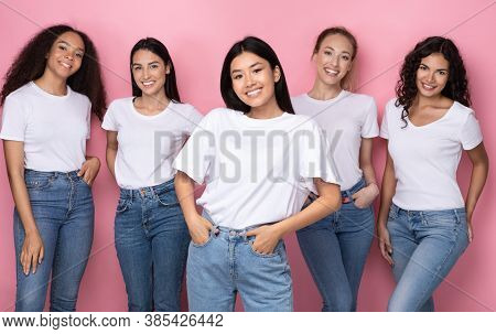 Cheerful Asian Woman With Diverse Group Of Ladies Standing Together Smiling To Camera Over Pink Back