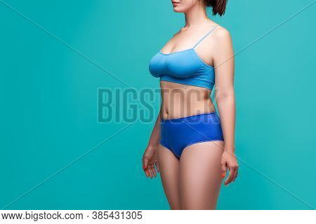 Beautiful Sexy Woman In Blue Underwear On Turquoise Background, Perfect Female Body