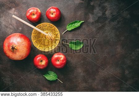 Jewish New Year - Rosh Hashanah. Apples, Pomegranate And Honey On A Dark Rustic Background. Traditio