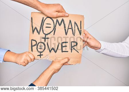Hands of caucasian people asking for women rights holding banner with woman power message over isolated white background