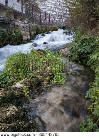Mountain Stream Plava Voda In Travnik In Autumn During The Day.