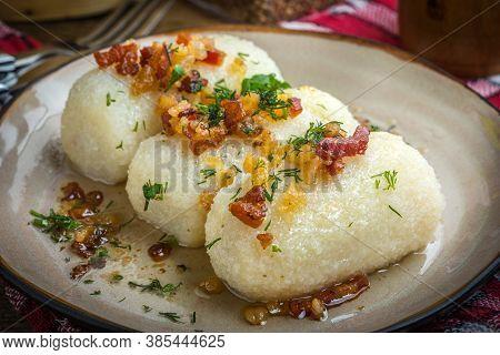 Potato Dumplings Stuffed With Minced (kartacze) Meat On Wooden Table.