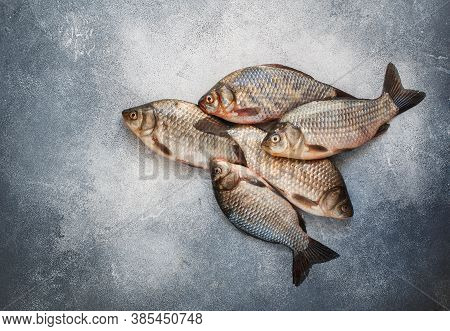 Crucians. Freshly Caught Raw Fish On A Gray Concrete Or Stone Background. Selective Focus, Top View