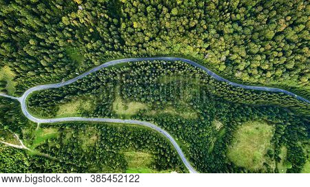 The Road In The Forest Was Shot From A Birds Eye View. Photo Taken With A Drone.