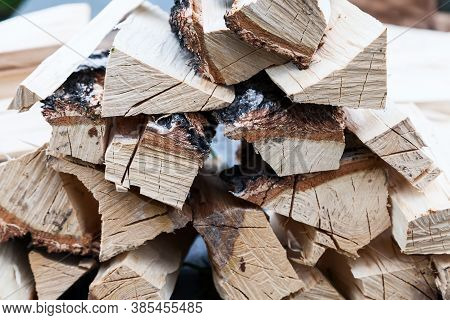 A Stack Of Chopped Wood To Start A Fire Before The Winter Season. Dried Wood Pallets With Textured W