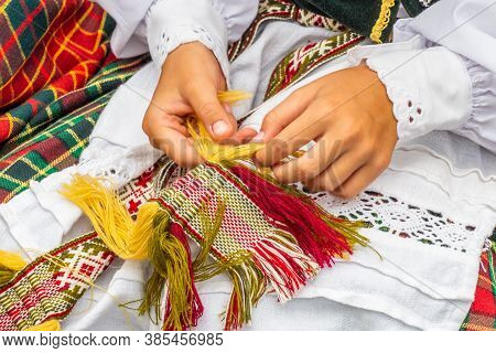 Lithuanian National Dress Ornament. Girl Dressed In Traditional Clothes Lithuanian