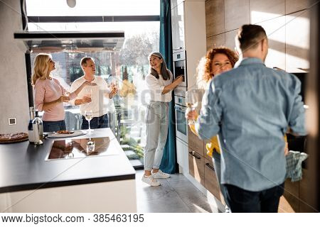 Smiling Asian Woman Making Coffee For Guests