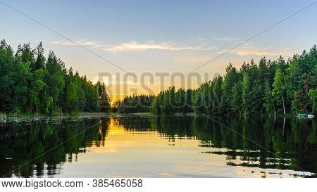 Lake At Sunset With Reflection Of Trees In The Water.  Haukivesi Lake, Saimaa Lake System, Savo, Fin
