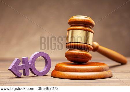 Transgender Symbol And Judge Gavel On Brown Background. Concept Of Prohibition Or Permission For Par