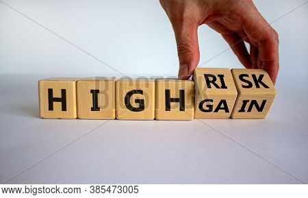 Cube Form The Expression 'high Risk, High Gain'. Male Hand. Beautiful White Background. Business Con