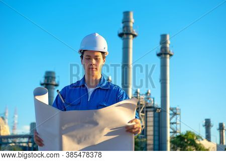 Engineer Inspecting In Industrial Oil Refinery. Industry 4.0 Concept. Background Blurred Concept.