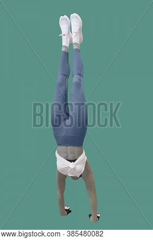 Female Mannequin Dressed In Sportswear, Performing A Handstand.  Isolated On Green Background. No Br