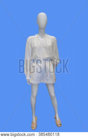 Full Length Female Mannequin Dressed In Summer Fashionable Clothes, Isolated On Blue Background. No