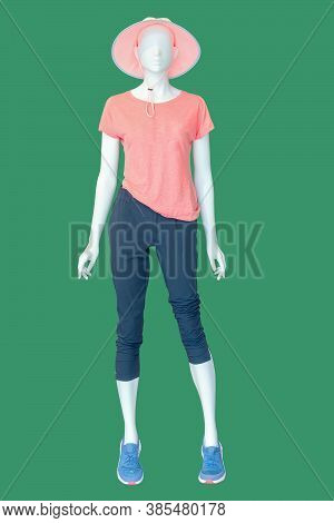 Full Length Female Mannequin Dressed In Summer Fashionable Clothes, Isolated On Green Background. No