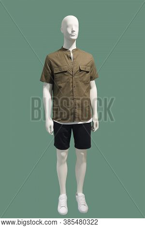 Full-length Male Mannequin Dressed In Brown Short Sleeve Button-down Shirt And Black Shorts, Isolate