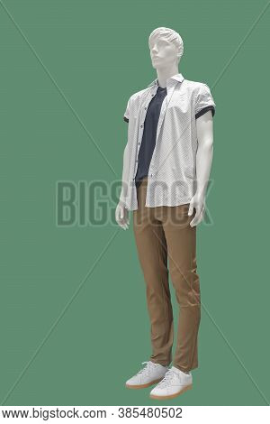 Full-length Male Mannequin Dressed In Summer Casual Clothes, Isolated On Green Background. No Brand