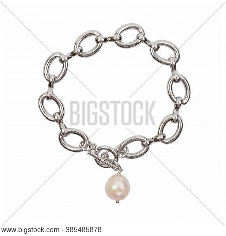 Women`s Wrist Bracelet Of Steel Chain With Baroque Pearl Pendant Isolated On White