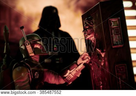 SEPTEMBER 13 2020: Scene from Star Wars The Empire Strikes Back - Han Solo frozen in carbonite with Bounty Hunter Boba Fett and Darth Vader - Hasbro action figure