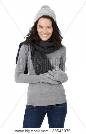 Portrait of happy attractive woman in winter clothes, scarf, cap and gloves, isolated on white.