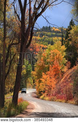 Off road vehicle on a scenic back road in San Juan mountains, Colorado during autumn time