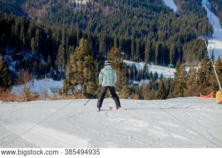 Skiing People And The Chair Lifts Of Ski Region In Ukraine