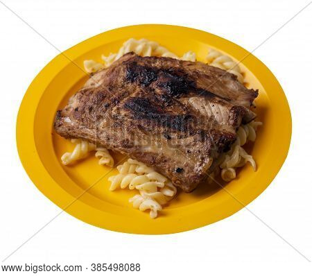 Grilled Pork Ribs With Pasta. Grilled Pork Ribs On Yellow Plate Isolated On White Background. Grille
