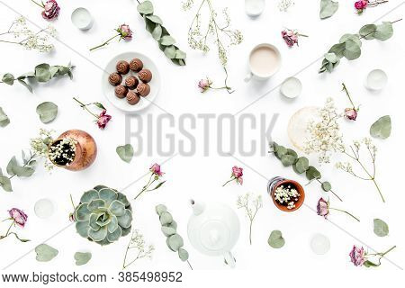 Workspace With Rose Buds, Leaves Eucalyptus, Succulent, Tea, Cup Of Cocoa, Sweets On White Backgroun