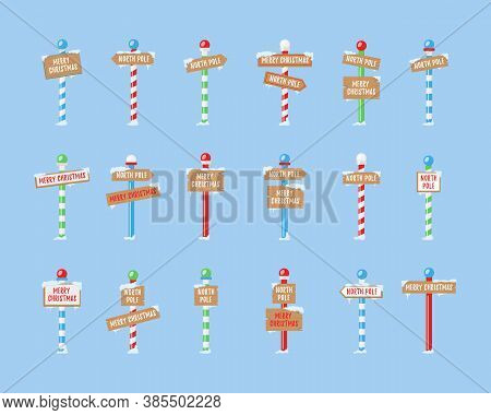 Cute Collection Of North Pole Signs Or Christmas. Set Of Wooden Street Signs In The Snow, Winter Poi