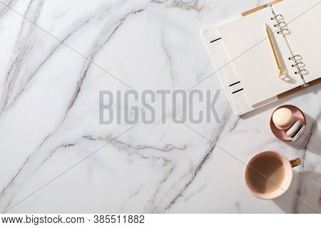 Diary For The Year 2021, Pen, Coffee, Macaron Cookie On Straw Woven Placemat