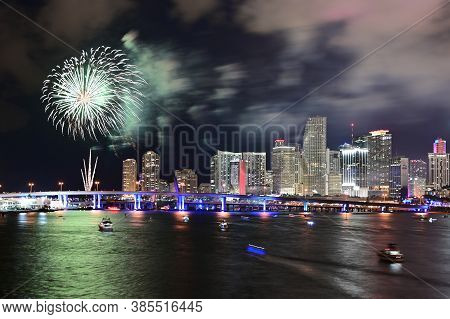 Miami, Florida - July 4, 2019 - Fireworks Above City Of Miami Skyline Reflected On Biscayne Bay.
