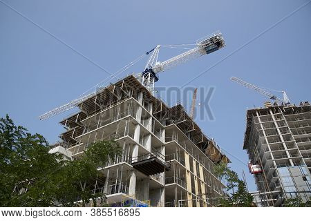 Toronto, Ontario / Canada - Aug 31, 2020 : Cranes Over The Condominium Construction Site, Toronto, O