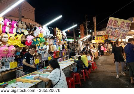 Nantou, Taiwan - May 15th, 2019: night marketplace with vendor and people shop at Puli town, Nantou, Taiwan