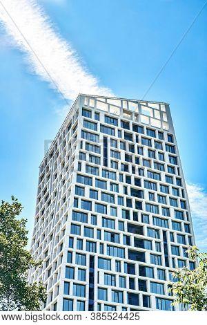 Izhevsk, Russia - June 16 2020. Exterior Of Modern Multistory Building Against Blue Sky
