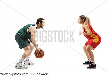 Full length profile shot of a man playing a basketball match against a woman isolated on white background