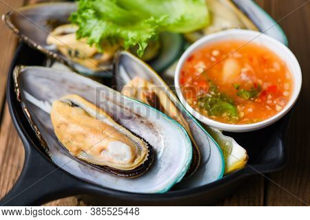 Fresh Mussels On Black Bowl And Seafood Sauce Shellfish Steamed Mussels
