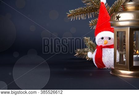 Christmas Lantern With A Snowman And Christmas Tree Twigs. Christmas Decoration With Copy Space Suit