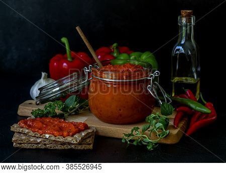 Roasted Red Pepper Relish Ajvar Or Aivar. Traditional Balkan Vegetable Caviar With Green And Red Bel